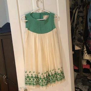 Silk embroidered baby doll dress.